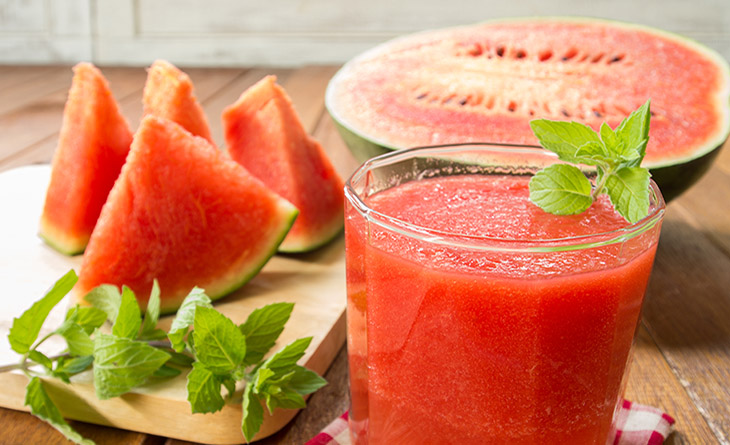 Fresh watermelon and glass of watermelon smoothie