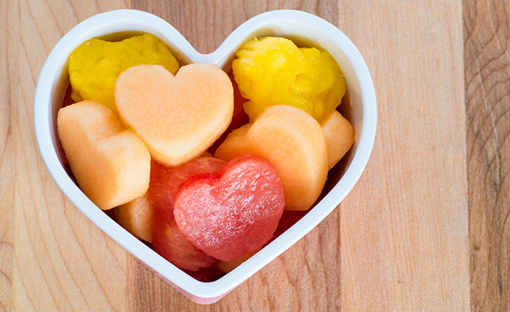 Valentines Day child friendly healthy treat with heart-shaped fruit cantaloupe watermelon and pineapple